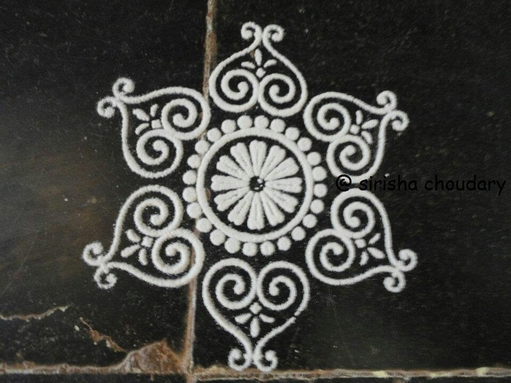 With rice flour..traditionally rice flour is used for rangoli in India