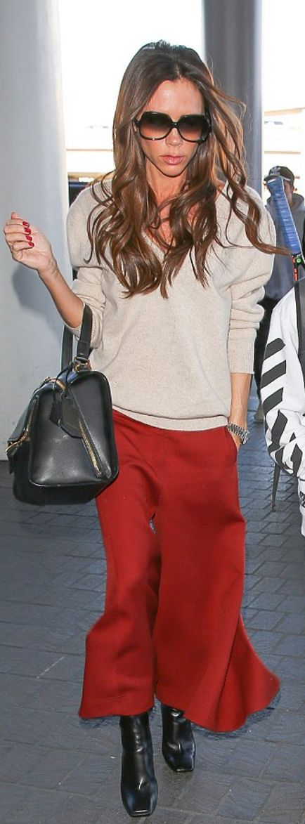 Victoria Beckham: Sunglasses – Culter and Gross Pants and sweater – Victoria Beckham Collection
