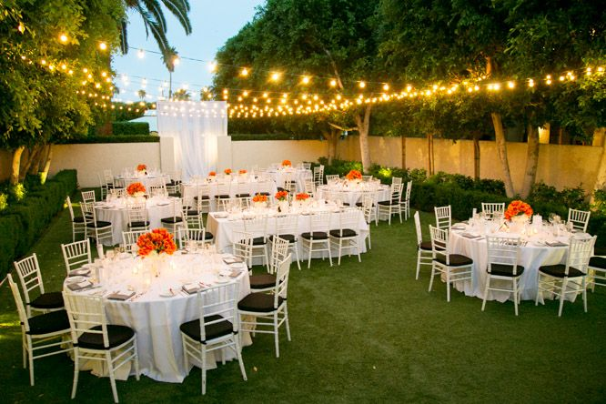 Here is a backyard wedding done well! Soft, warm light glows from the string…