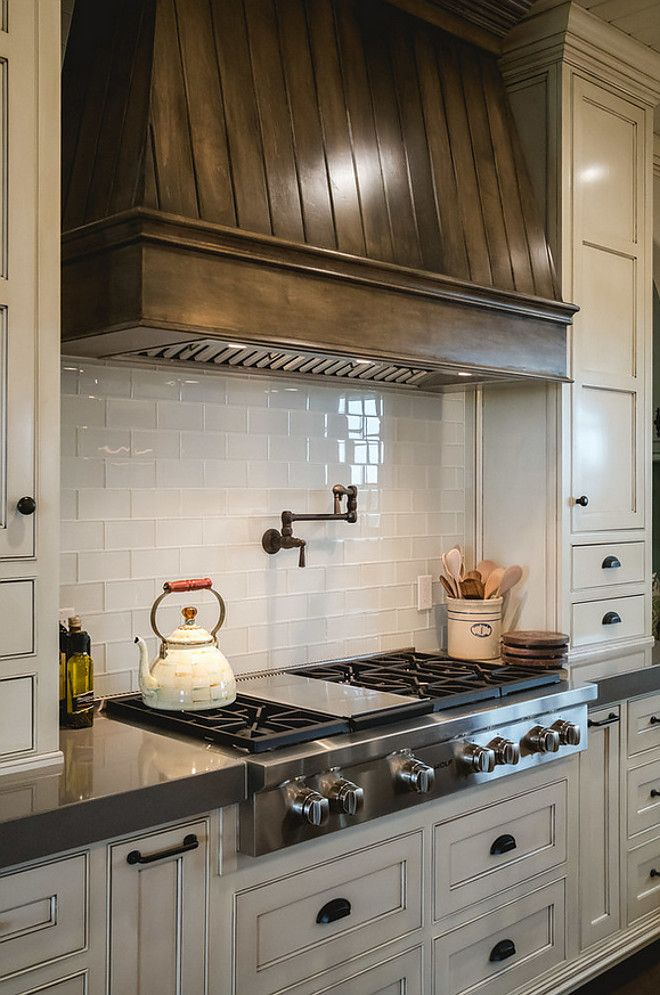 Kitchen features Tobacco stained kitchen hood, creamy white cabinets and grey quartz countertop. tabacco-stained-kitchen-hood-and-creamy-white-cabinets Alicia Zupan