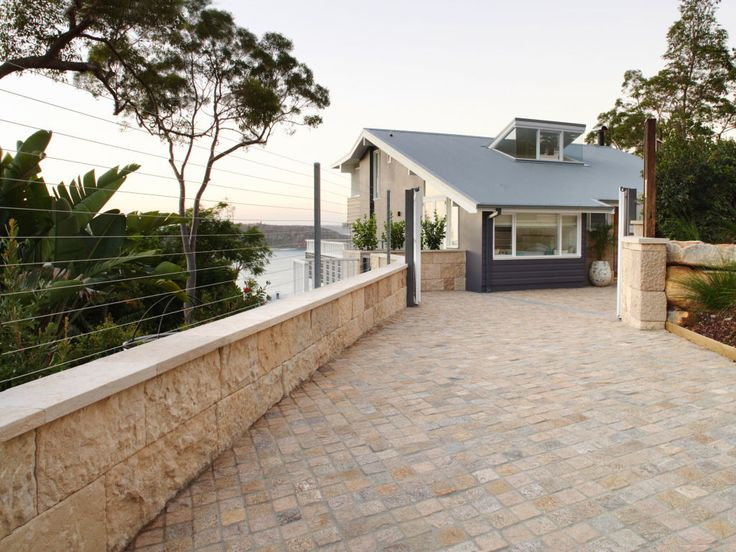 Eco Outdoor Sesame cobblestones and Berrimah traditional walling used on driveway. #livelifeoutdoors #naturalstoneflooringandwalling Annabelle Chapman Architects | River Run Constructions | Eco Outdoor | Sesame cobblestones | Berrimah traditional format walling | Outdoor design | Garden design | Outdoor paving | Outdoor design inspiration | Outdoor style | Outdoor ideas | Paving ideas | Contemporary garden design | Driveway ideas | Stone walling ideas | Outdoor tiles | Stone tiles | Luxury…