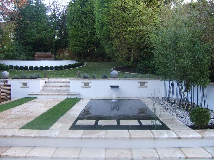 A Contemporary Pond For This Brighton Garden With Natural Travertine Limestone Edging And Stepping Stones