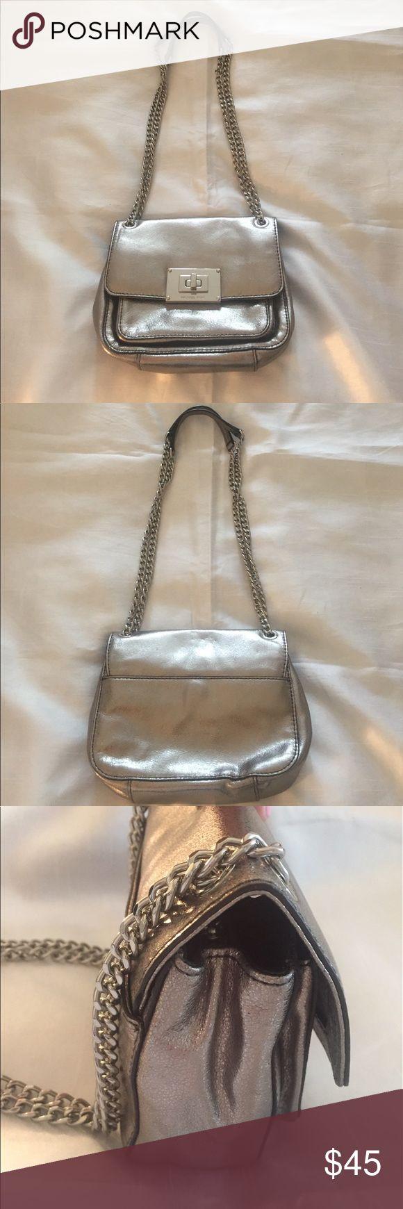 "Michael Kors Metallic Silver Shoulder Bag Like new! Used twice. Metallic silver chain (when worn as shoulder bag) measures 12.5"" in length. Body of bag measures almost 8"" long and 6"" high. Michael Kors Bags Mini Bags"