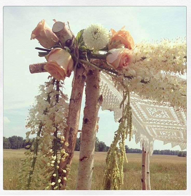 Handmade wooden arbor with lace and flowers