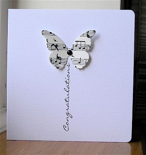 handmade card ... clean and simple ... black and white ... butterfly punched from sheet music ... sentiment in vertical position as a trail ... design easily adaptable to a balloon or flower ... sweet and simple ...