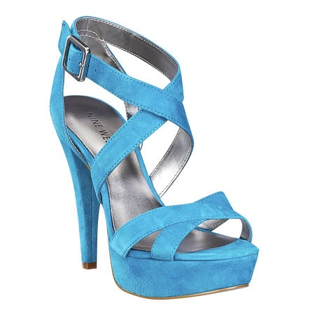 """As seen in the July issue of OK! Magazine.....Criss cross platform sandal with covered heel.  Adjustable ankle strap with buckle closure.  Measurements: heel 4 3/4"""" and platform 1"""".  This style is available exclusively @ Nine West Stores & ninewest.com."""