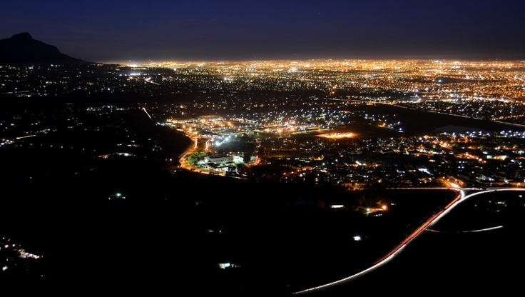 City Lights  From the top of Ou Kaapse Weg (Old Cape Road) overlooking Cape Town's Southern Suburbs - Devil's Peak on the left.   © 2012 Robin Bownes. All Rights Reserved.