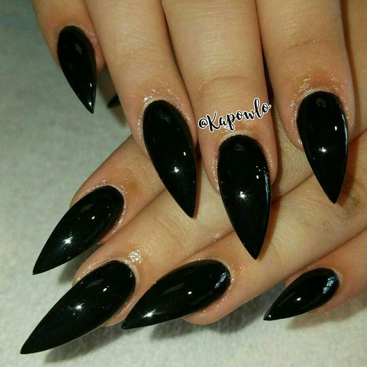 Black stilleto nails. Almond nails. Sharp nails. Perfect nails.