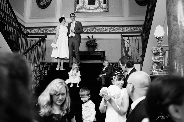 Bride and groom overlooking their guests at Shrigley Hall.
