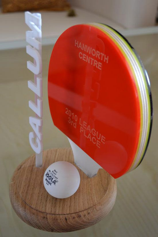 Table Tennis league trophy for local youth centre made with recycled acrylic and oak.