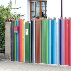A bright and colorful fence made from giant pencil crayons.