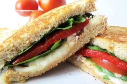 From Pioneer Woman...my idea of a great lunch..Basil, tomato, pepper sandwich made on a panini press!