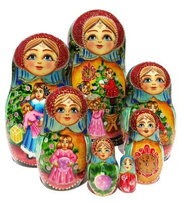 Russian hand painted 7 piece nesting doll features children with Christmas…