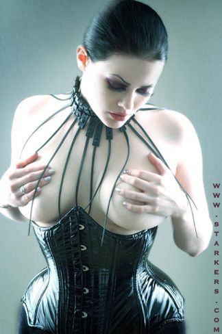 Black patent leather Short Bat corset by Starkers Corsetry. Model: IO, Photo: Tom Sapp