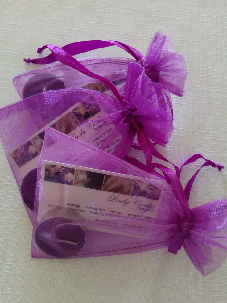 Bridal expo giveaways - tea light candles and business cards in chiffon bags