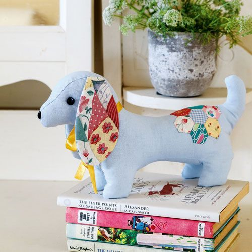 Make special moments last with the Dachshund Autograph Dog Softie pattern by Allison Dey Malacaria. Combining cute dachshunds and the classic autograph dog, this pooch is waiting to be signed by friends, celebrities or loved ones to mark a special occasion. Allison has added cute patchwork ears and an English paper pieced hexagon flower to make her softie unique and super-cute.