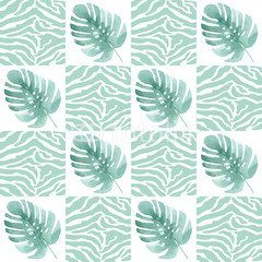 Seamless pattern with tropical leaves on the texture of the skin