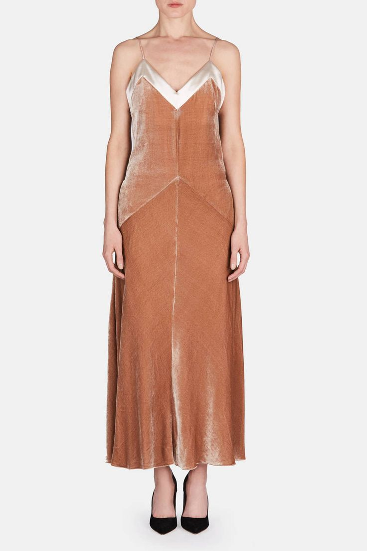 A refreshingly simple silhouette enriched by regal velvet, this slipdress redefines easy glamour. It's modern in its understated quality yet feels romantically Old World in its neutral palette and rich textures. This style is one of the stars of Hillier Bartley's spring 2016 collection, an example of the duo's unique approach to luxury. It proves that the designers have gone above and beyond in combining vintage-inspired charm with contemporary shapes. Brightened by a glossy silk satin…