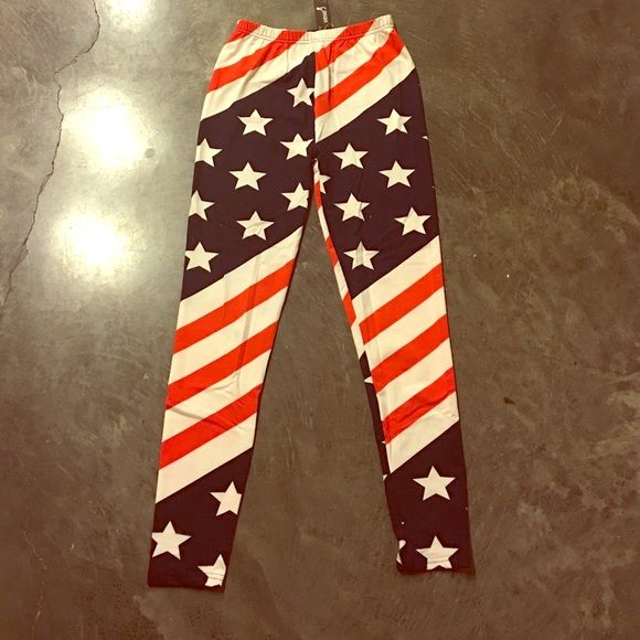 American Flag Leggings New with tags American flag leggings. The tags say One size fits all but I believe they fit more like a small. Pants Leggings