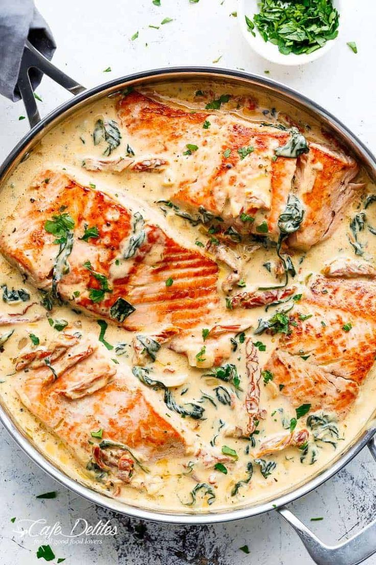 Creamy Garlic Butter Tuscan Salmon (OR TROUT) is such an incredible recipe! Restaurant quality salmon in a beautiful creamy Tuscan sauce! | https://cafedelites.com #tuscankitchens