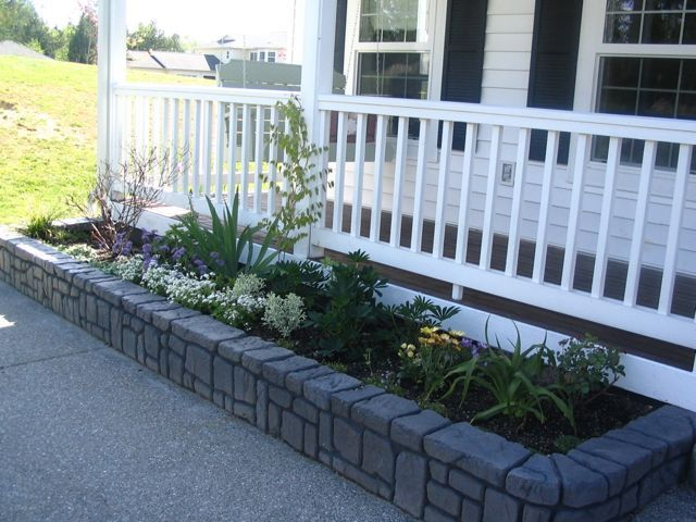 Raised stamp concrete flower beds scravings concrete for Raised flower bed ideas front of house