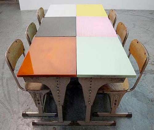 Japanese architecture firm Studio Schemata created flat surfaces on these vintage school desks by pouring color epoxy on the top board, which was uneven due to deterioration and scribbling. Each desk retains its individuality, however, through the use of translucent color in the epoxy–deep points are mirrored by dense colors and shallow points by more transparent shades.