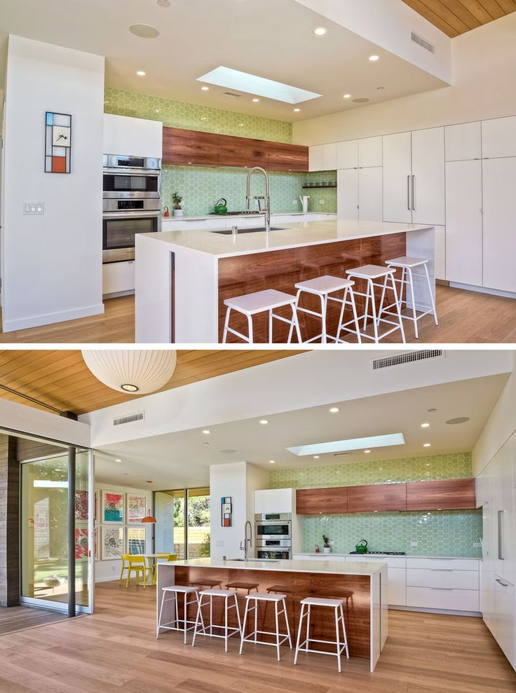 Light green hexagonal tiles are used as a backsplash in this modern kitchen. A large white and wood island compliments the white and wood cabinetry used in the room.