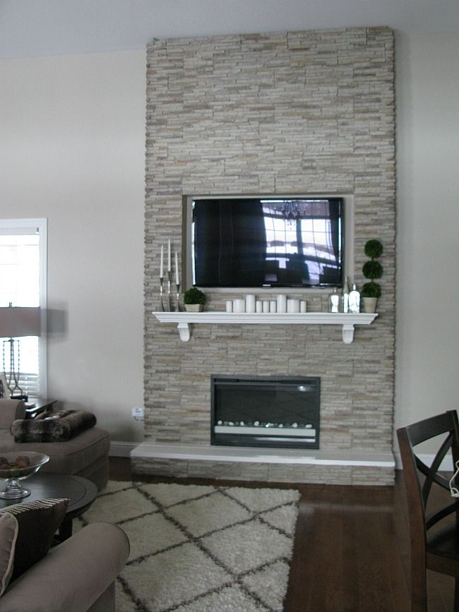 """DIY """"Fireplace"""" Stones over wood frame, electric inset fireplace"""