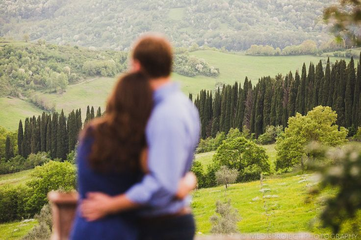 beautiful young couple embraced looking at the panorama