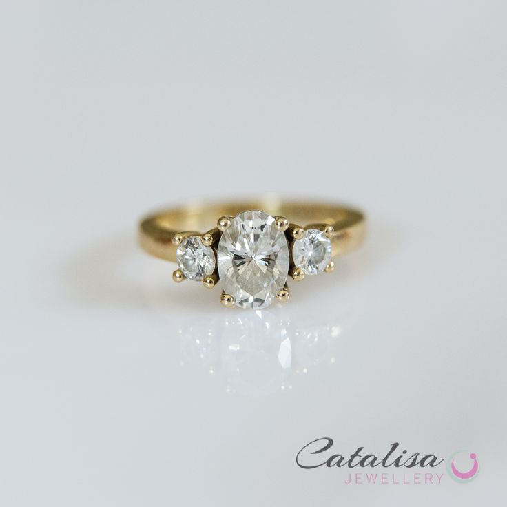Trilogy Diamond Ring set in Yellow Gold.