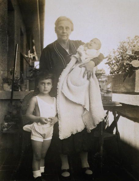 Margot Frank and baby Anne Frank with their grandmother, circa 1930.