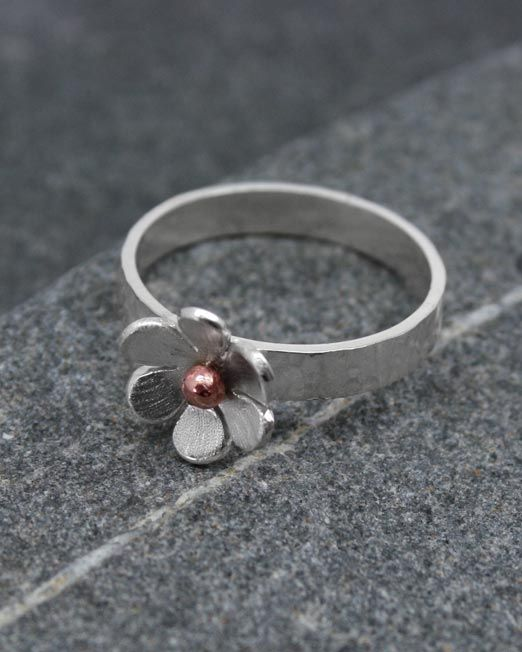 A beautiful single silver flower ring with a copper or brass bead centre.  The flower is 11mm in diameter and is set on a 3.5mm flat hammered band.  #brass #copper #daisy #flower #handmade #ring #silver #starboardjewellery #jewellery #cornwall #uk #gb #westcountry #devon #england #silversmith #pretty #jeweller #jewellers #handmadejewellery