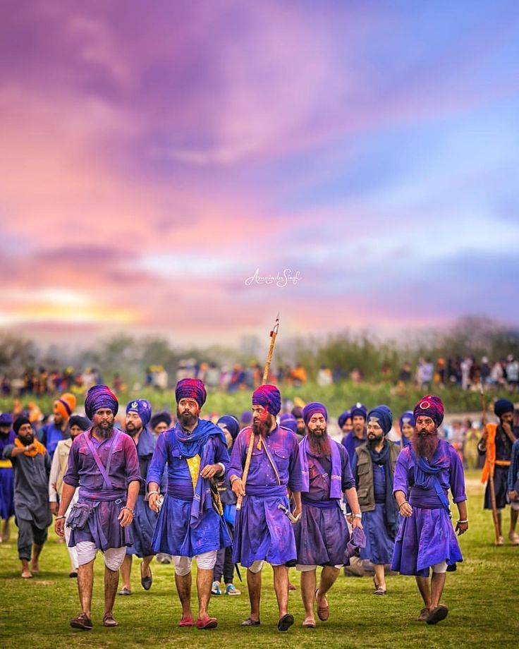 """The Lions of Punjab. During the festival of Holla Mohalla Sikhs from around the world converge to the historical city of Anandpur Sahib in Punjab India. It is a day full of color and extraordinary displays of martial arts. Men and Women donned in traditional clothing walk around the fields proudly with their heads held high. Thousands gather around to witness skilled horsemen from across the lands participate in various maneuvers displaying their amazing talents and skills."" amazing capture…"