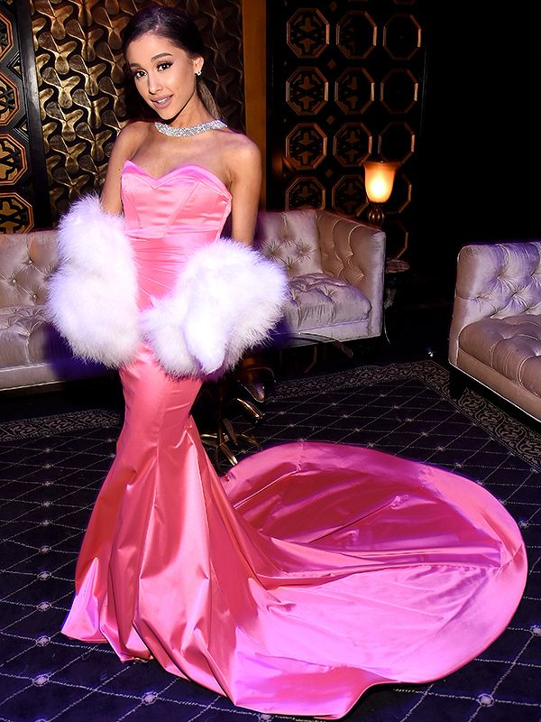 Ariana Grande at the MTV Movie awards 2016 pairing a body-hugging satin pink Michael Costello gown with a white fur stole and – fittingly – a sparkling Le Vian choker necklace.