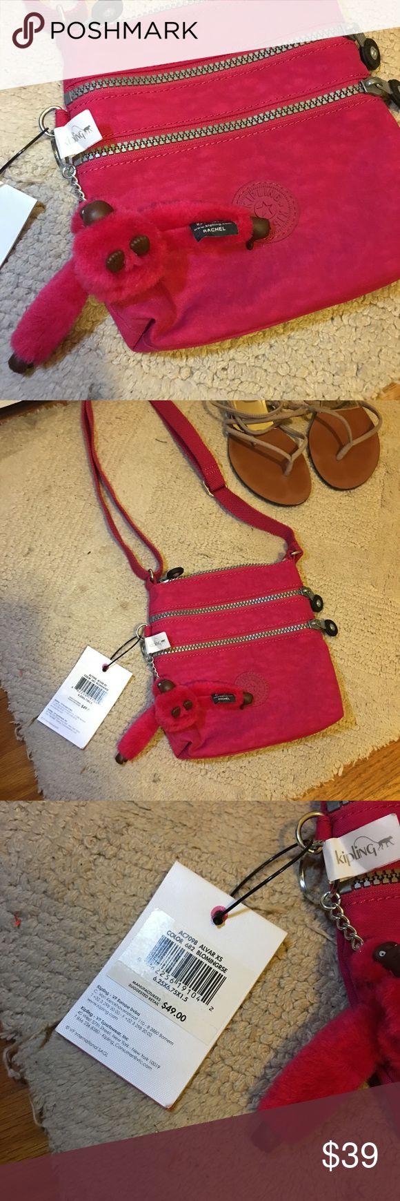"""NWT Kipling crossbody bag Kipling branded. New with TAG. Colored in pink.  A terrific little crossbody bag for a look that is both functional and fashion forward. Great for hands-free travel or weekend jaunts, this pleasantly practical bag is outfitted with a zipped main compartment for wallet and keys and two zipped pockets on the front for easy access to cell phone, metro card and lip gloss.  Dimensions: 6.25"""" L x 6.75"""" H x 1.5"""" D  Retail $49 plus tax Kipling Bags Crossbody Bags"""