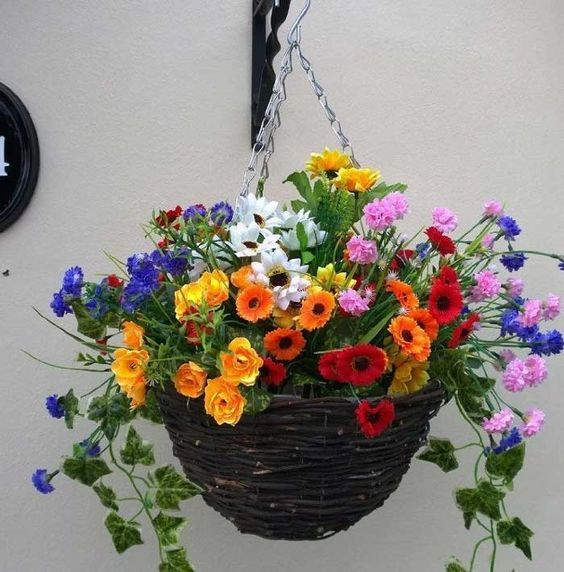 Pretty artificial hanging basket of wild flowers