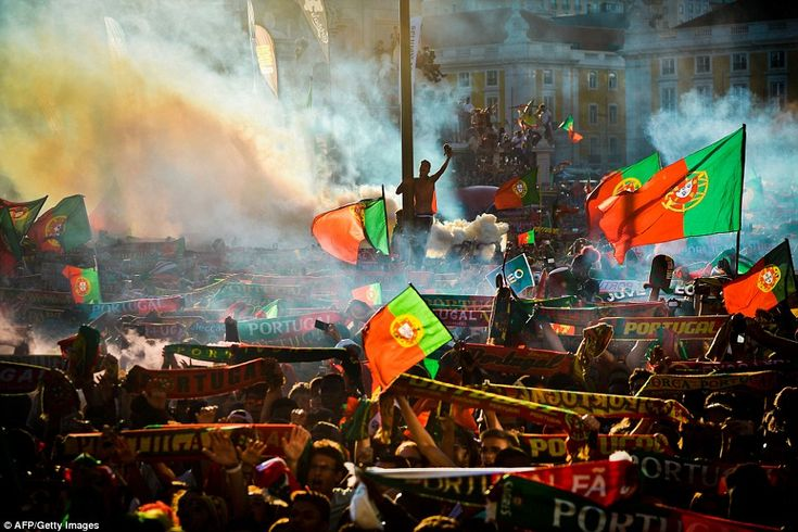Portugal's supporters turn Terreiro do Paco square in Lisbon green and red with flags and ...