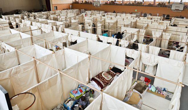Privacy for Fukushima refugees, done with paper. shigeru ban