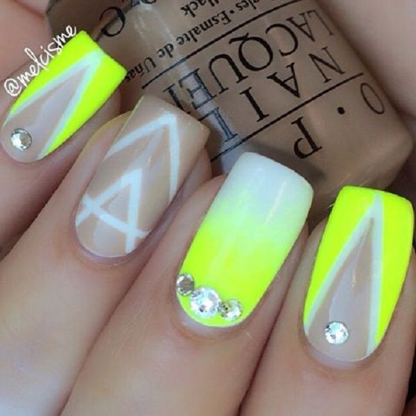 Abstract themed yellow nail art design. This nail art design uses white and light yellow colors to give out that wonderful gradient effect. Various strips of white polish are also sued as lining for the yellow v-shaped designs. On top are silver beads added.