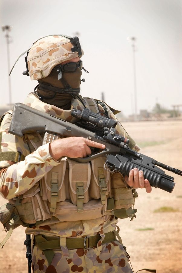 Australian soldier in Iraq with his Steyr AUG  bullpup 5.56mm assault rifle.