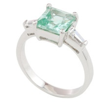 """""""Fair & Square""""  $59.99 CAD -  This stunning ring features a square cut jade coloured triple A cubic zirconia centre stone flanked by a clear rectangular CZ on either side. The ring is finished in rich rhodium. Nickel and lead free. Size 6."""