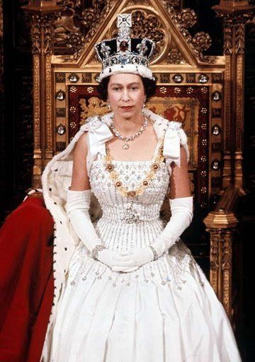 Amazing dress! Queen Elizabeth II is seen during the State Opening of Parliament in London in April 1966.