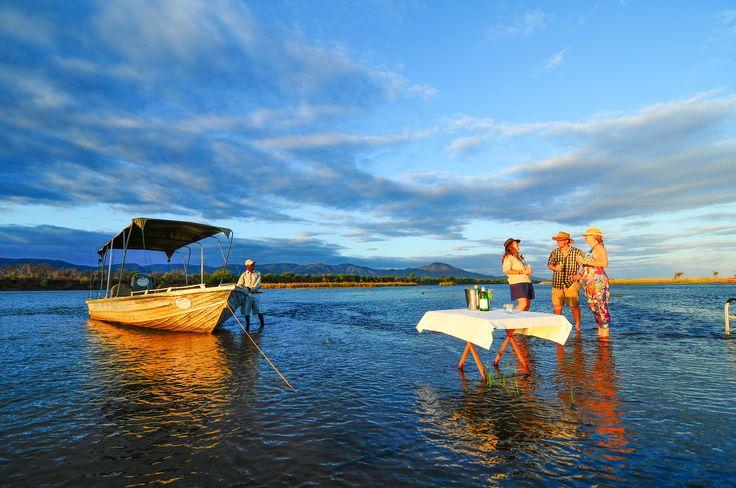 Boat cruise and Sundowners on the Zambezi River, Lower Zambezi National Park, Zambia.  Visit www.royalzambezilodge.com