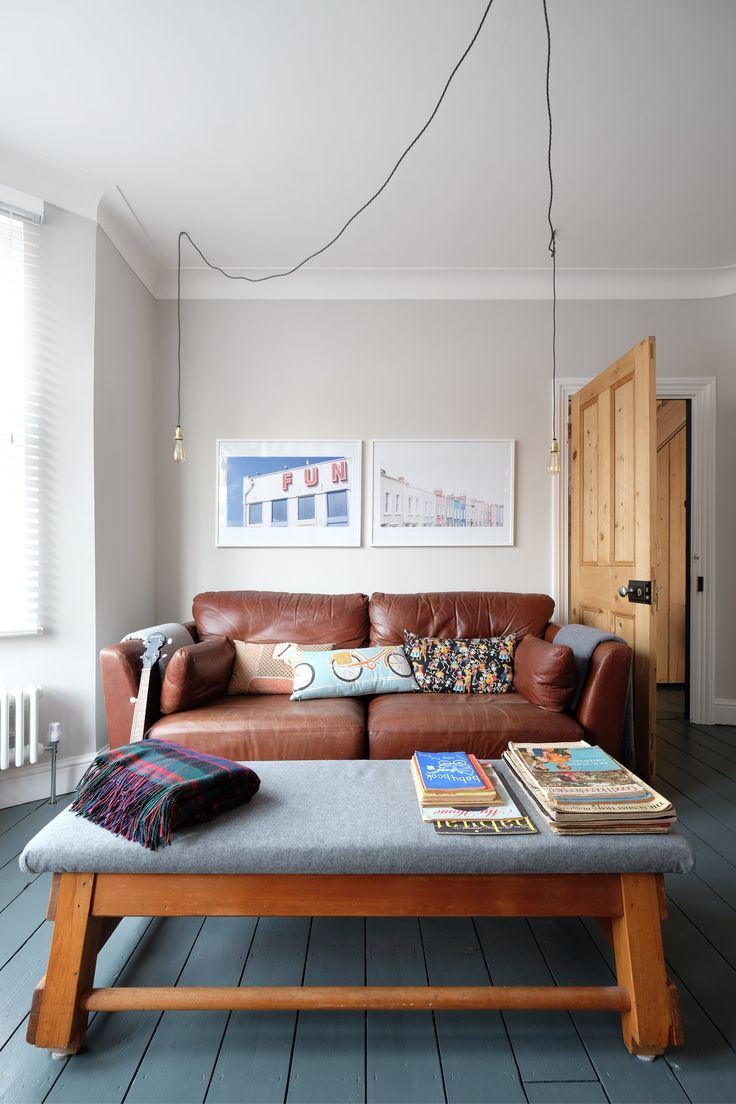 """G Plan sofa, """"El's mum made the cushions with fabric we bought in America,"""" Aine tells me. """"The foot stool/coffee table is the top of an old gym horse that we got at Kempton antiques market and recovered."""" Lighting from Dowsing and Reynolds."""