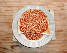Baked beans on toast- A popular British comfort food - Wikipedia, the free encyclopedia:  Every day 2.3 million British people eat Heinz baked beans. During the depression my gramma's family in Michigan lived on canned pork and beans on baked potatoes. Inexpensive and filling.