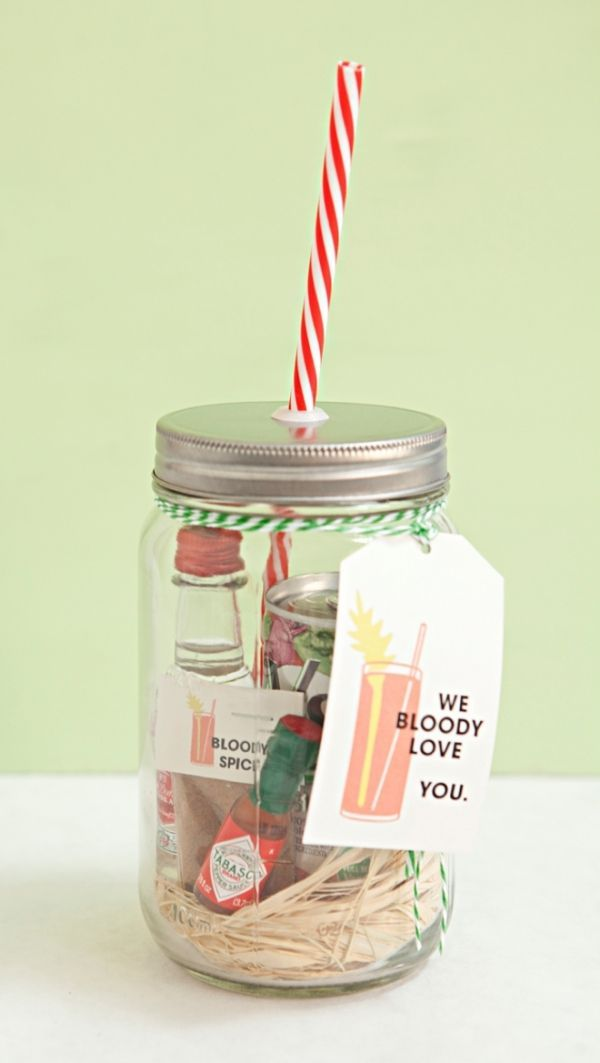 fun and whimsical approach to gifts in a jar, create cocktail kits that contain ingredients of common drinks. Here, load everything necessary for a single-serving Bloody Mary in a jar and top off with a lid and straw!