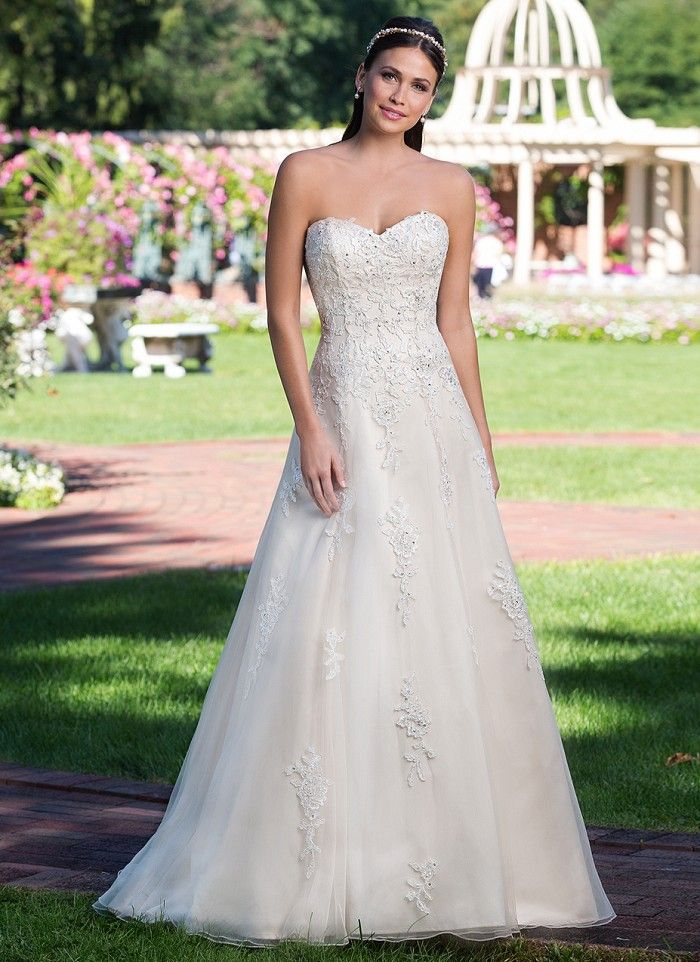 Beaded corded lace adorns this sweetheart A-line tulle gown with a chapel length train. This classic silhouette is both figure flattering and easy to wear. Further highlight your waist with the addition of our sized belt, style 3923B. https://www.sinceritybridal.com/wedding_dress/3923