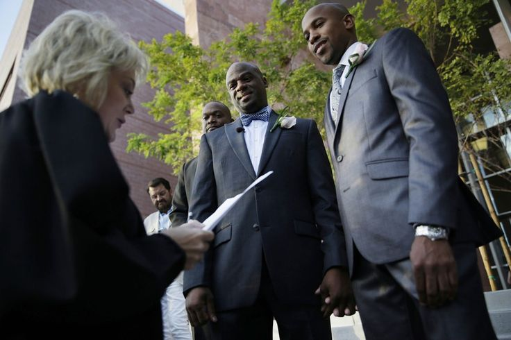Sherwood Howard, right, and Nevada state Sen. Kelvin Atkinson get married by Nancy Allf, a district court judge, outside of the Marriage License Bureau.