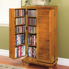"Compact cabinet stores over 600 CDs!    This attractive Mission-style cabinet fits in a small space, yet offers storage for 612 CDs, 298 DVDs or 172 VHS tapes! Made of solid oak, it fits in a space less than 24"" wide and blends with most decors."