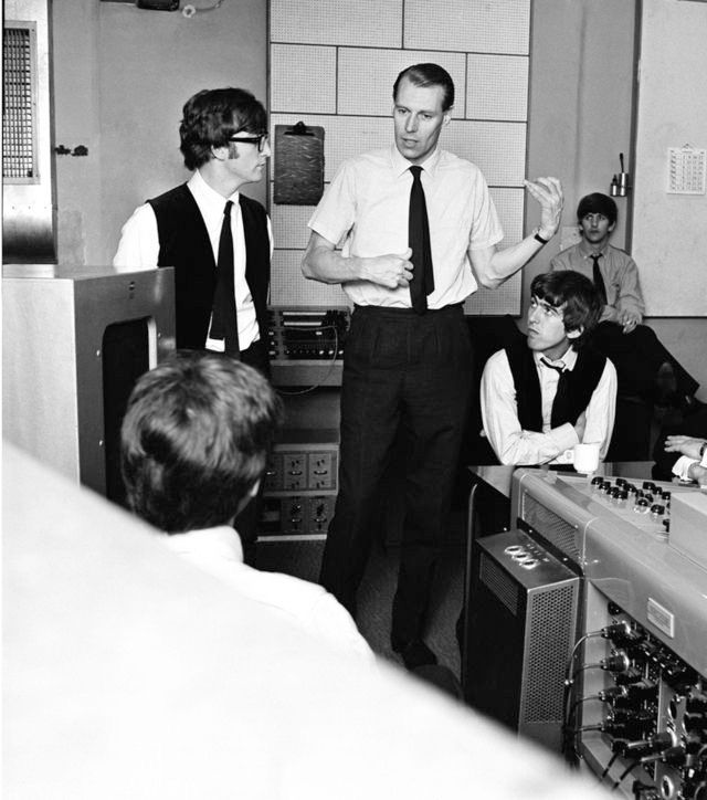 George Martin with the boys during the recording of A Hard Days Night, early 1964.
